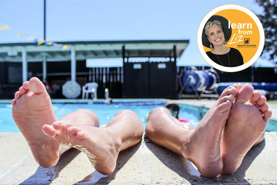 two pairs of legs hanging out a swimming pool