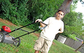 young teen with lawnmower