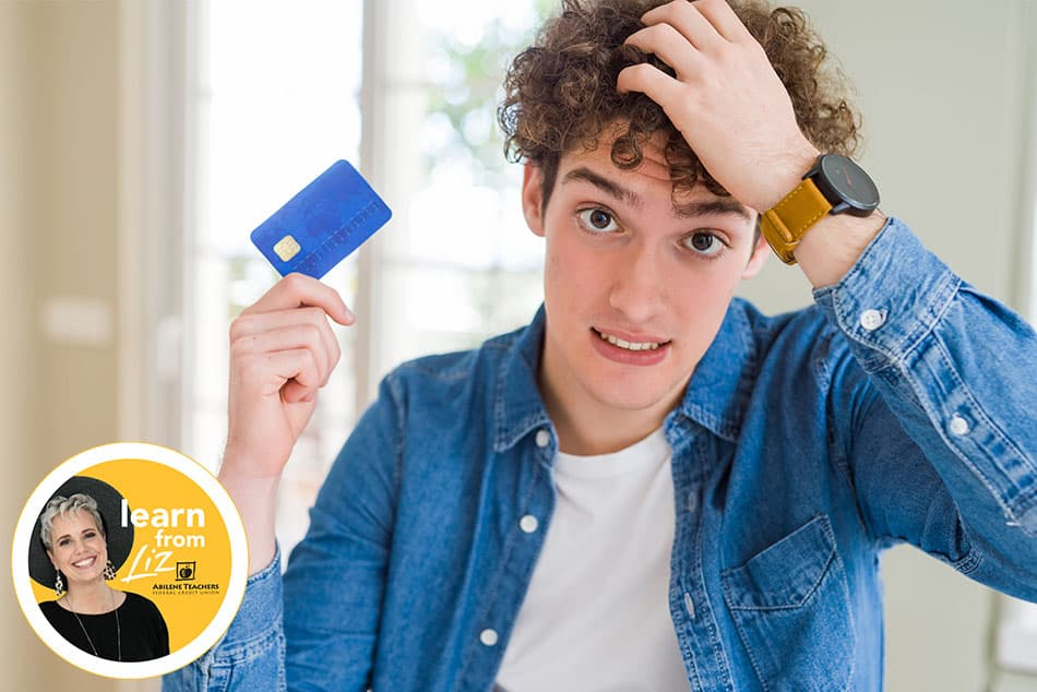 boy holding credit card with concerned face