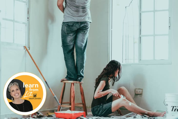 man and woman painting house