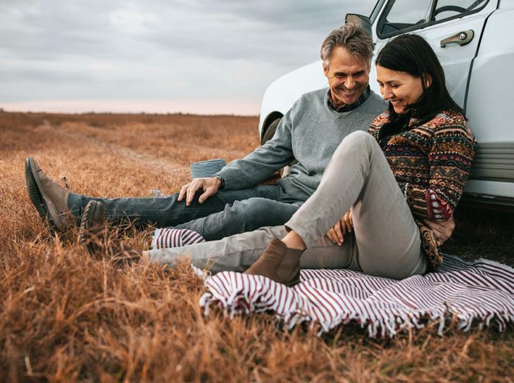 couple having picnic in field