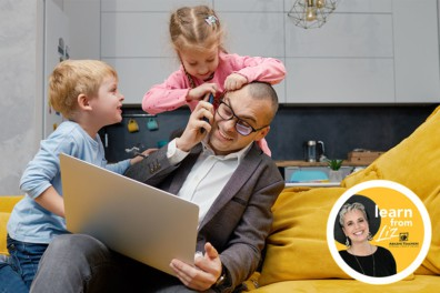 dad on laptop with kids crawling over him