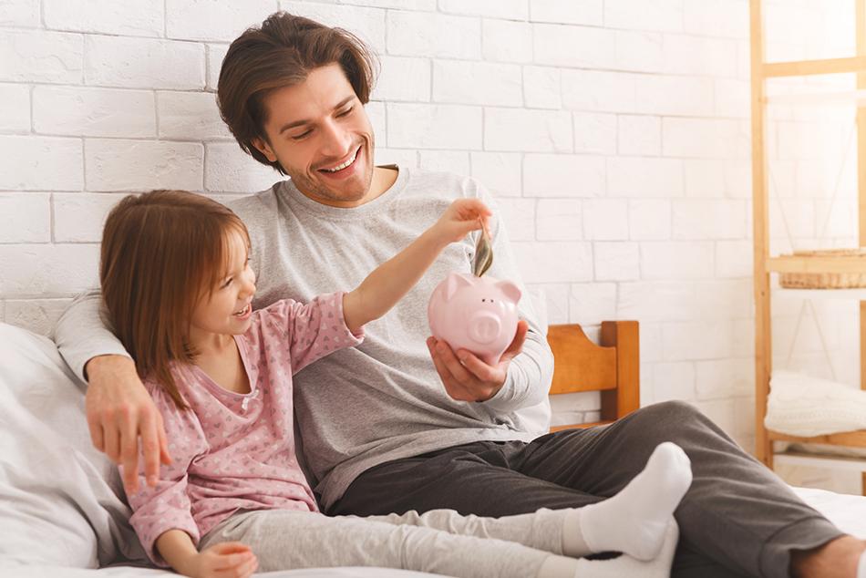 Dad Teaching Daughter About Saving