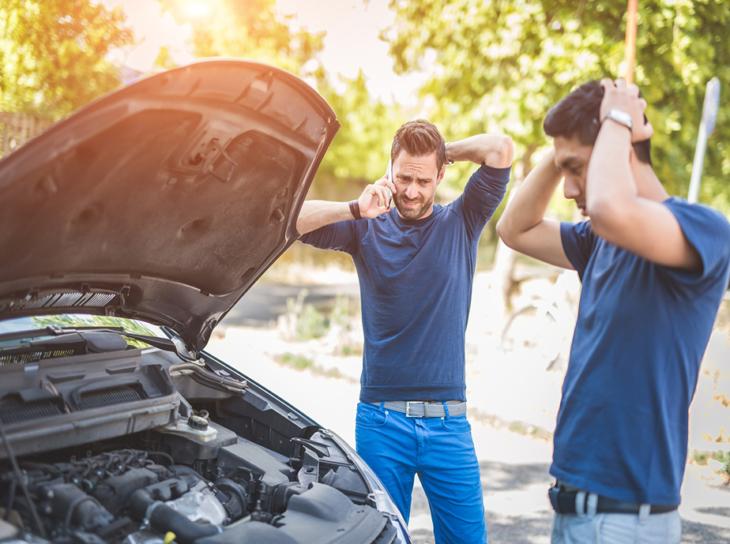 two men with broken down vehicle on roadside