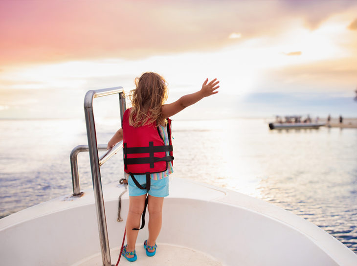 child on boat bow