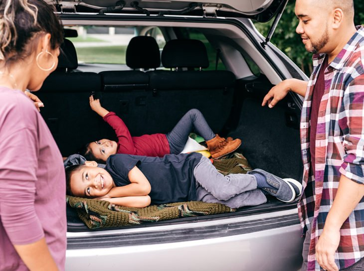 family playing in car