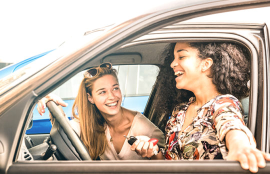 friends laughing in car