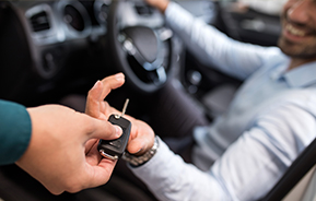 handing keys to new car
