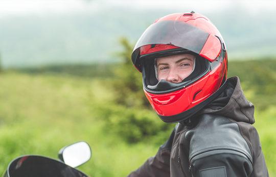 man on motorcycle helmet