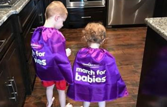 Two children in purple March for Babies capes