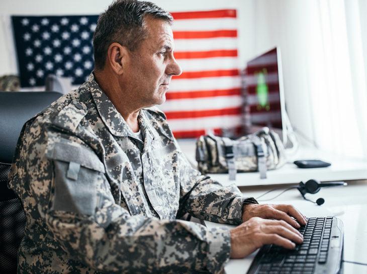 military man at computer