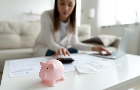 piggy bank and computer
