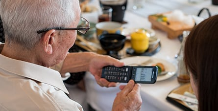 senior using flip phone
