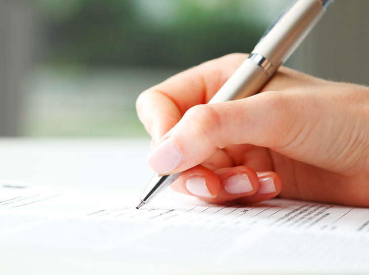 signing documents with pen