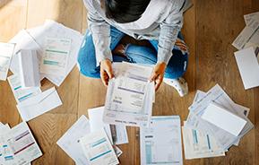sorting bills on floor