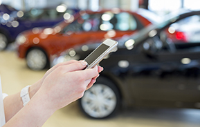 using smartphone at auto dealer
