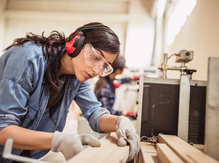 woman woodworking in shop